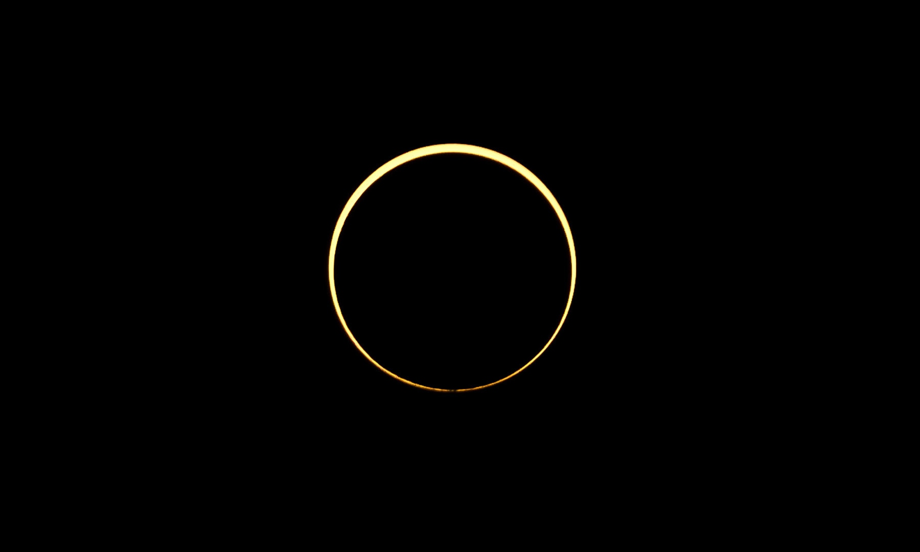 The moon passes between the sun and the earth during an annular solar eclipse in Singapore on December 26. — Reuters