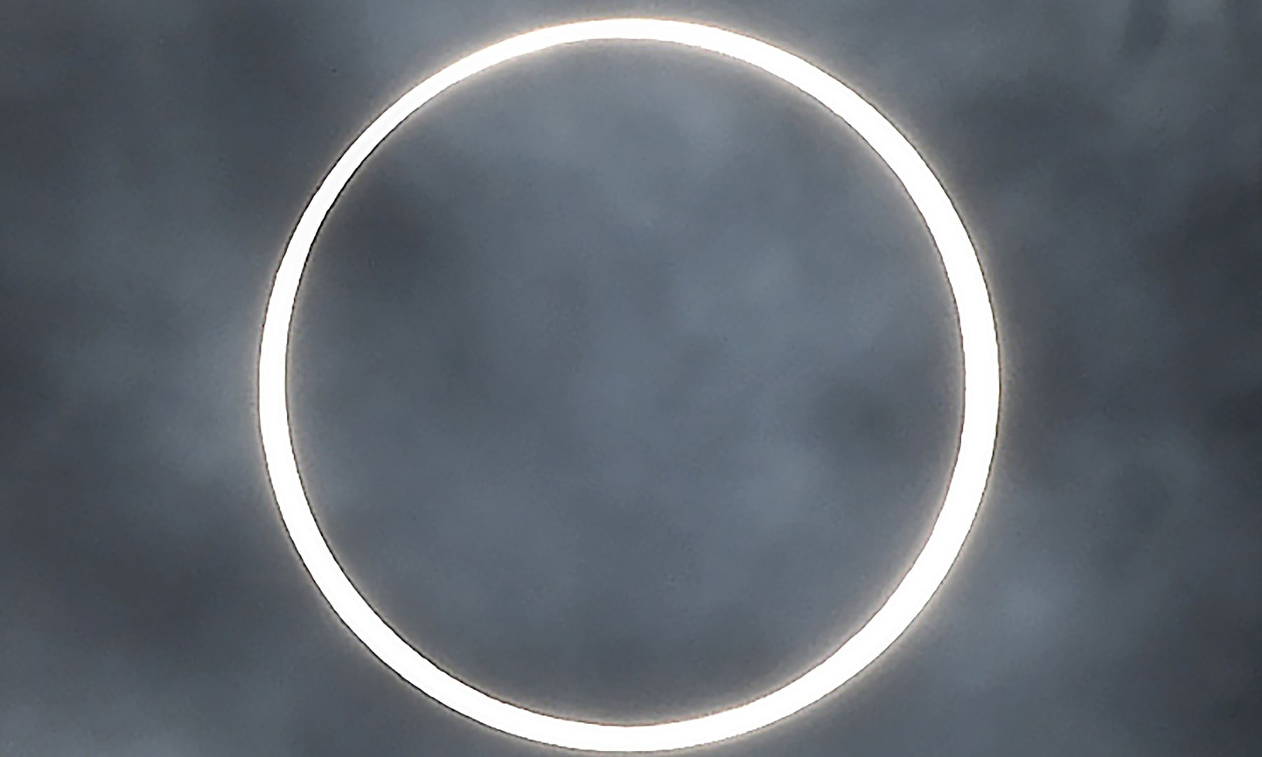 """The moon totally covers the sun in a rare """"ring of fire"""" solar eclipse as seen from the south Indian city of Dindigul in Tamil Nadu state on December 26. — AFP"""