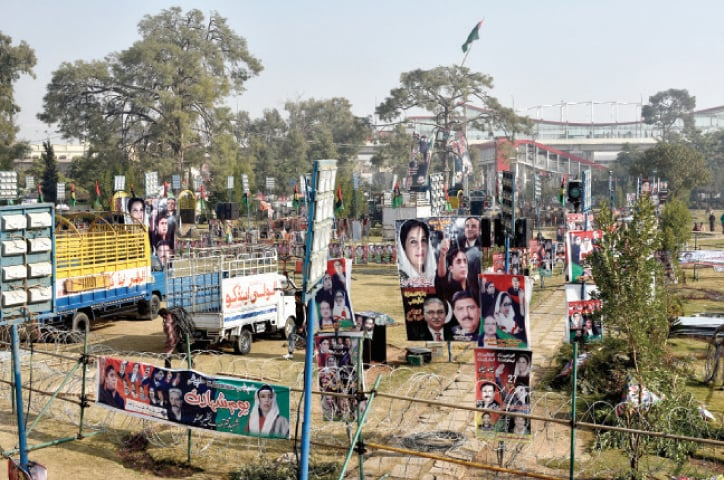 Preparations are being made at Liaquat Bagh for PPP's public gathering being held in connection with former prime minister Benazir Bhutto's death anniversary on Friday. — Photo by Tanveer Shahzad