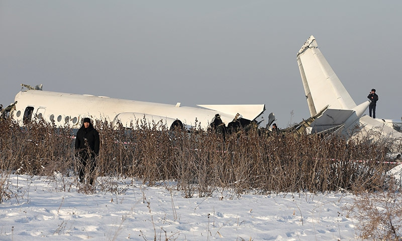 Emergency and security personnel are seen at the site of a plane crash near Almaty, Kazakhstan on December 27. — Reuters