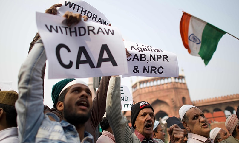 Protesters shout slogans during a demonstration against India's new citizenship law in New Delhi on Dec 27. — AFP
