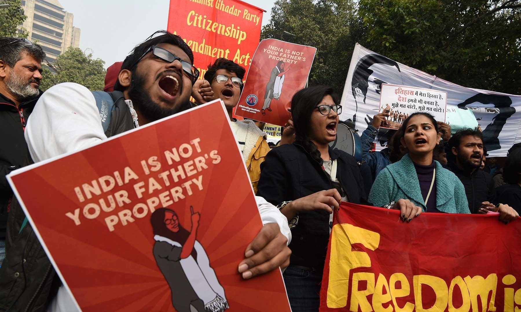 In this photo taken on December 24, protesters hold placards at a demonstration against India's new citizenship law in New Delhi. — AFP