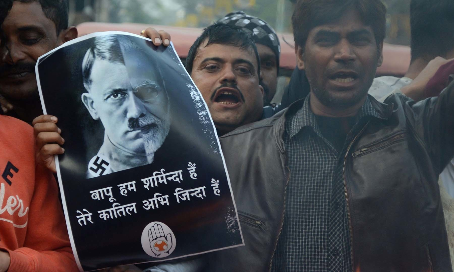 In this file photo taken on December 18, protesters hold a poster comparing Indian Prime Minister Narendra Modi to German chancellor and Nazi Party leader Adolf Hitler at a demonstration against India's new citizenship law in Siliguri. — AFP