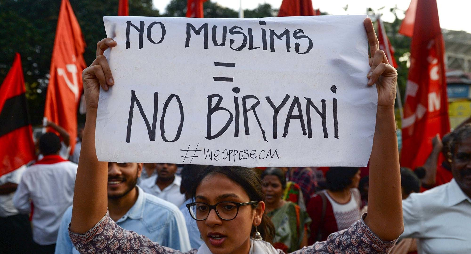 (FILES) In this file photo taken on December 16, 2019, protesters shout slogans and hold placards at a demonstration against India's new citizenship law. - From Netflix to Hitler, protesters are tapping pop culture and history as they vent their anger against Prime Minister Narendra Modi's new citizenship law -- and with deft use of India's beloved acronyms. (Photo by Arun SANKAR / AFP) — AFP or licensors