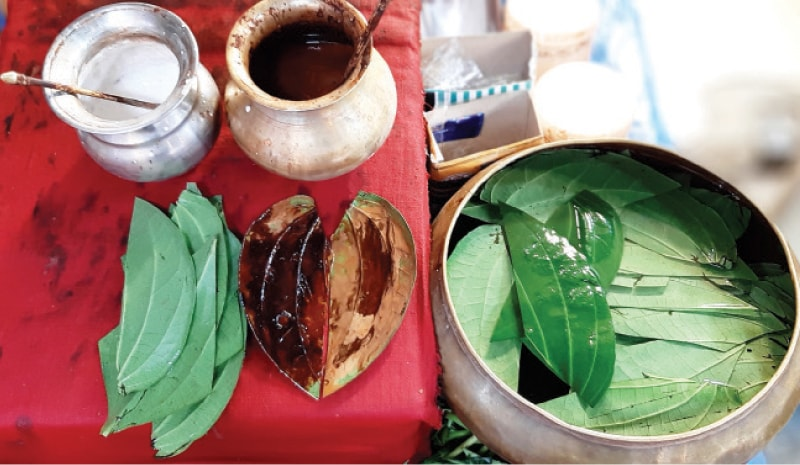 Katha soaked in lime is applied to the betel leaves, followed by areca nuts, tobacco and other spices and flavouring.