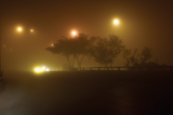 Fog decends on Zero Point in Islamabad on Saturday. — Photo by Tanveer Shahzad