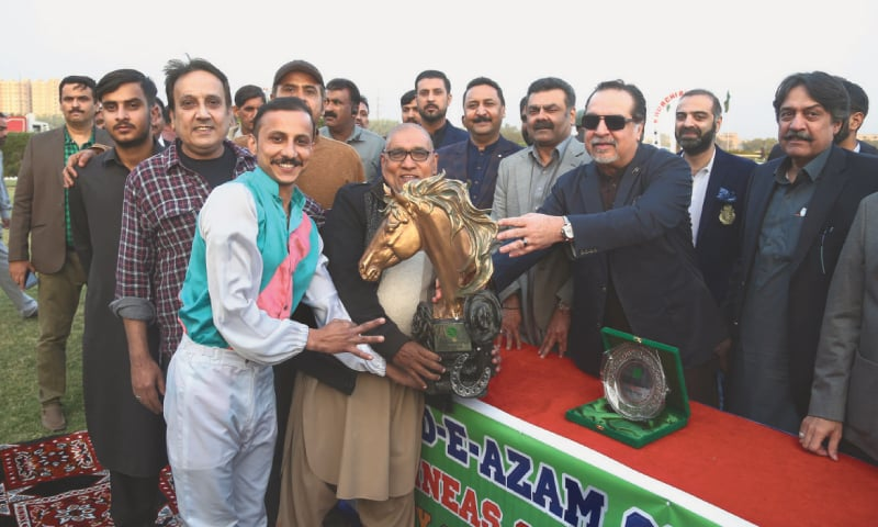 OWNER, rider and trainer of Big Bravo receive the cup from the chief guest Sindh Governor Imran Ismail as KRC President Syed Sadruddin Shah looks on.—White Star