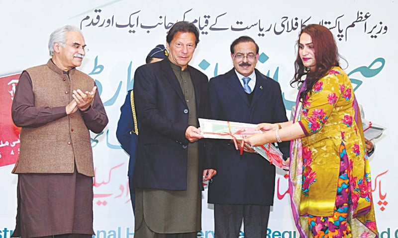 Islamabad: Prime Minister Imran Khan distributing Sehat Insaf Cards among members of the transgender community at a ceremony on Monday. Mr Khan criticised past governments for not accepting existence of the most vulnerable segment of society.—PPI