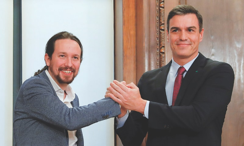 Madrid: Spain's acting Prime Minister Pedro Sanchez and Unidas Podemos (Together We Can) leader Pablo Iglesias shake hands as they present their coalition agreement at Parliament on Monday.—Reuters