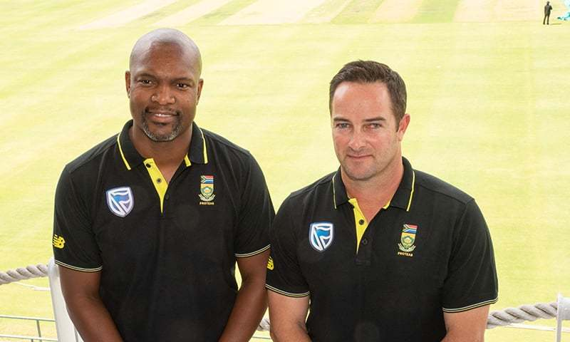 Enoch Nkwe(L), the South  African Cricket assistant coach, and Mark Boucher(R), the South African Cricket coach, pose for a portrait at the Newlands Cricket grounds in Newlands, on December 14. — AFP