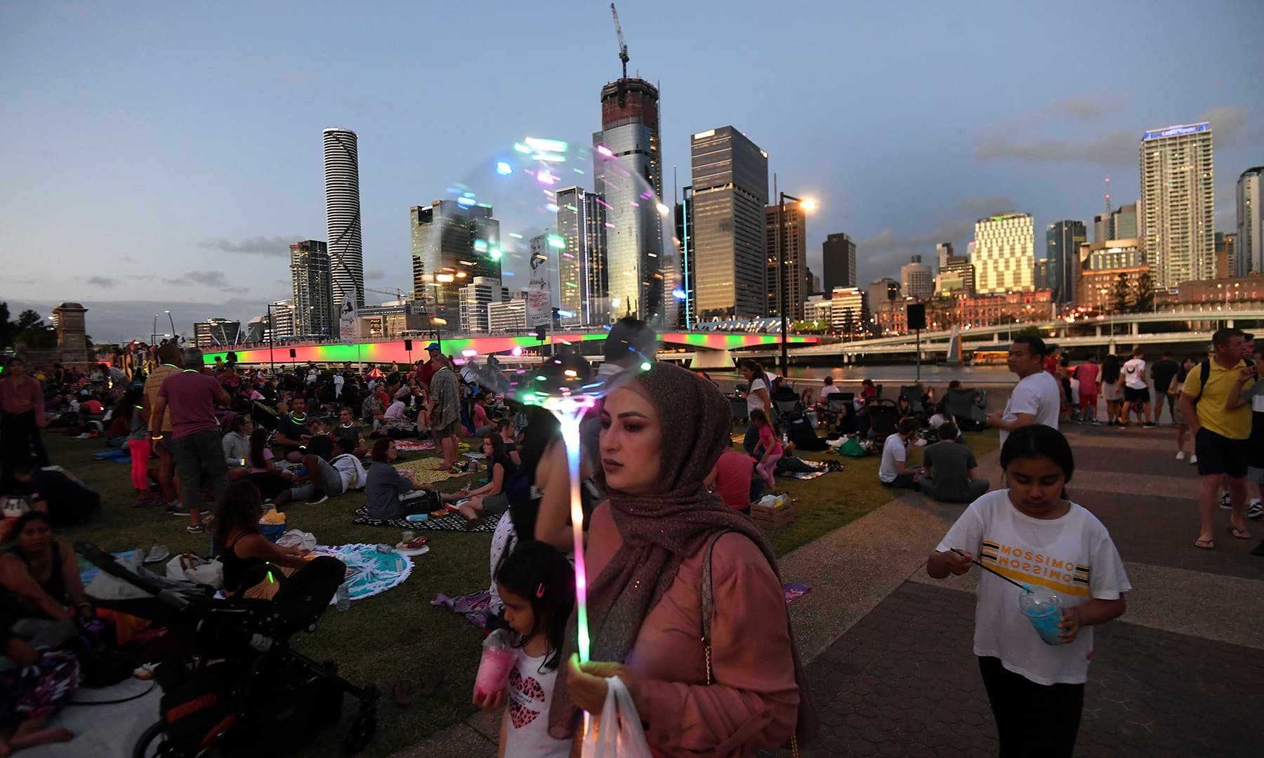 Crowds gather to watch New Year's Eve fireworks at South Bank in Brisbane, Australia, on Tuesday. — Reuters