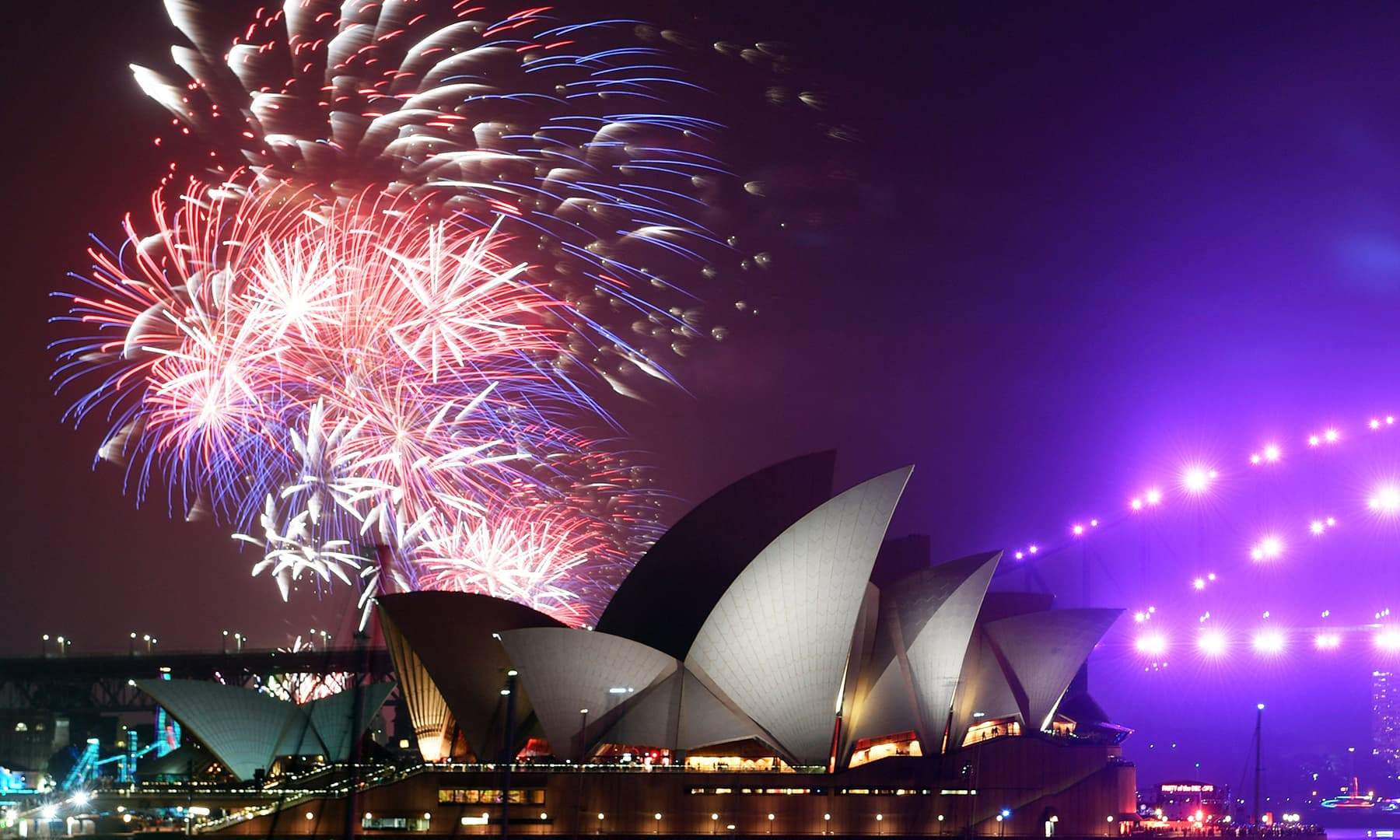 Fireworks are seen from Mrs Macquarie's Chair during New Year's Eve celebrations in Sydney, Australia, on Tuesday. — Reuters