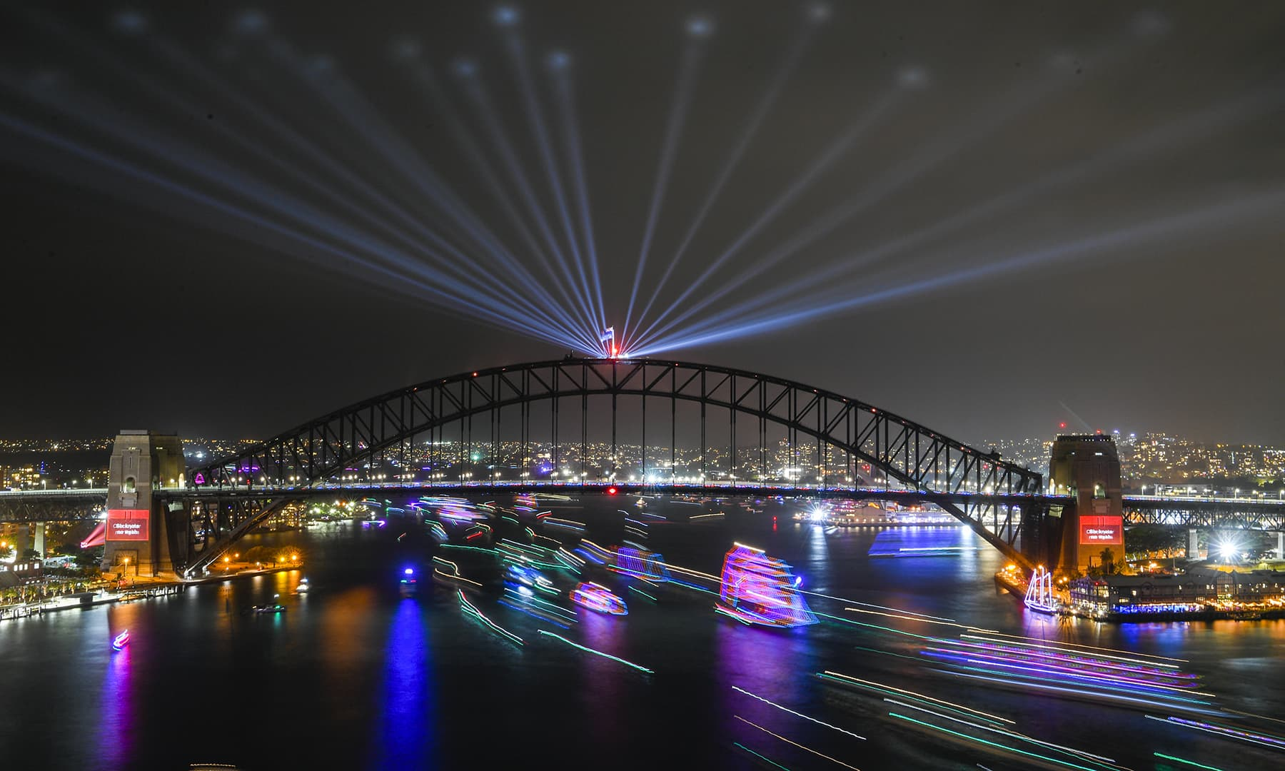 A long exposure image shows ships passing under the Sydney Harbour Bridge on Sydney Harbour at the end of the Year's Eve celebrations in Sydney, Australia, on Tuesday. — Reuters