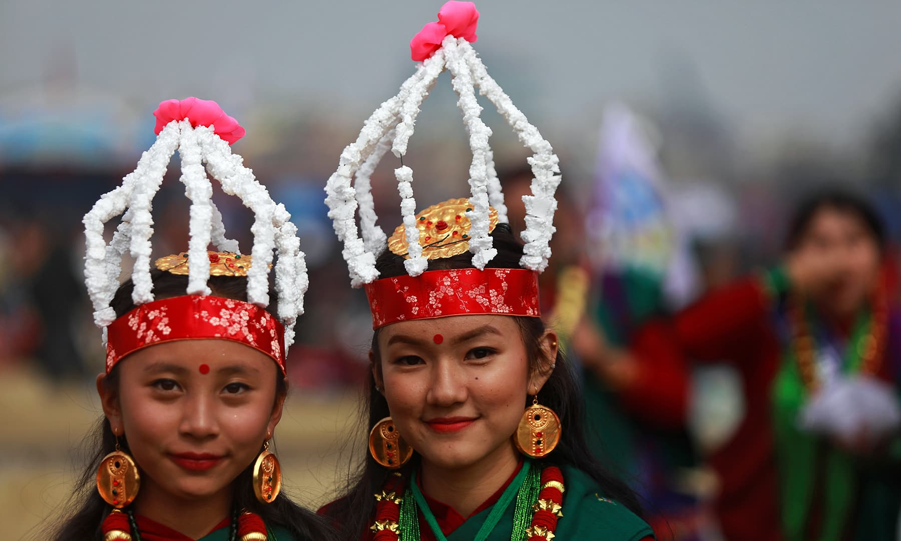 Gurung girls wearing a traditional costume pose as they take part in Tamu Lhosar parade, marking the beginning of the Gurung community's new year, in Kathmandu, Nepal, on Tuesday. — Reuters