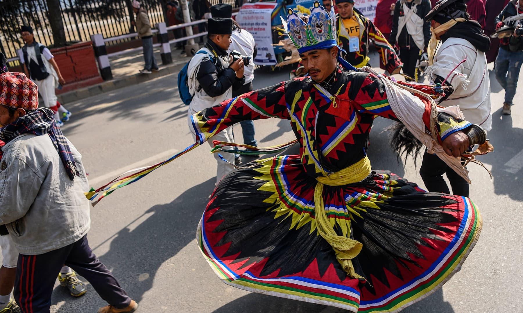 A member of the indigenous Gurung community wearing traditional attire dances as he takes part with others in a New Year celebration ceremony known as 'Tamu Lhosar' in Kathmandu on Tuesday. — AFP