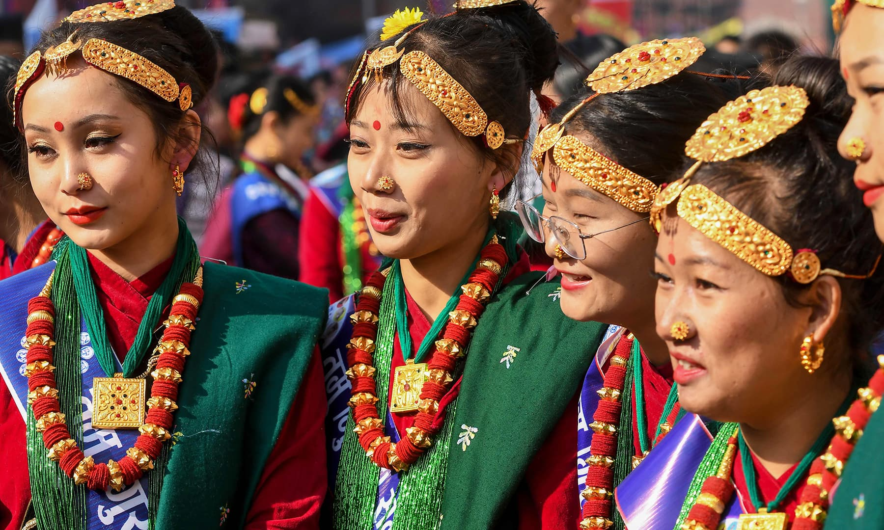 Members of the indigenous Gurung community wearing traditional attire react as they take part in a New Year celebration ceremony known as 'Tamu Lhosar' in Kathmandu on Tuesday. — AFP