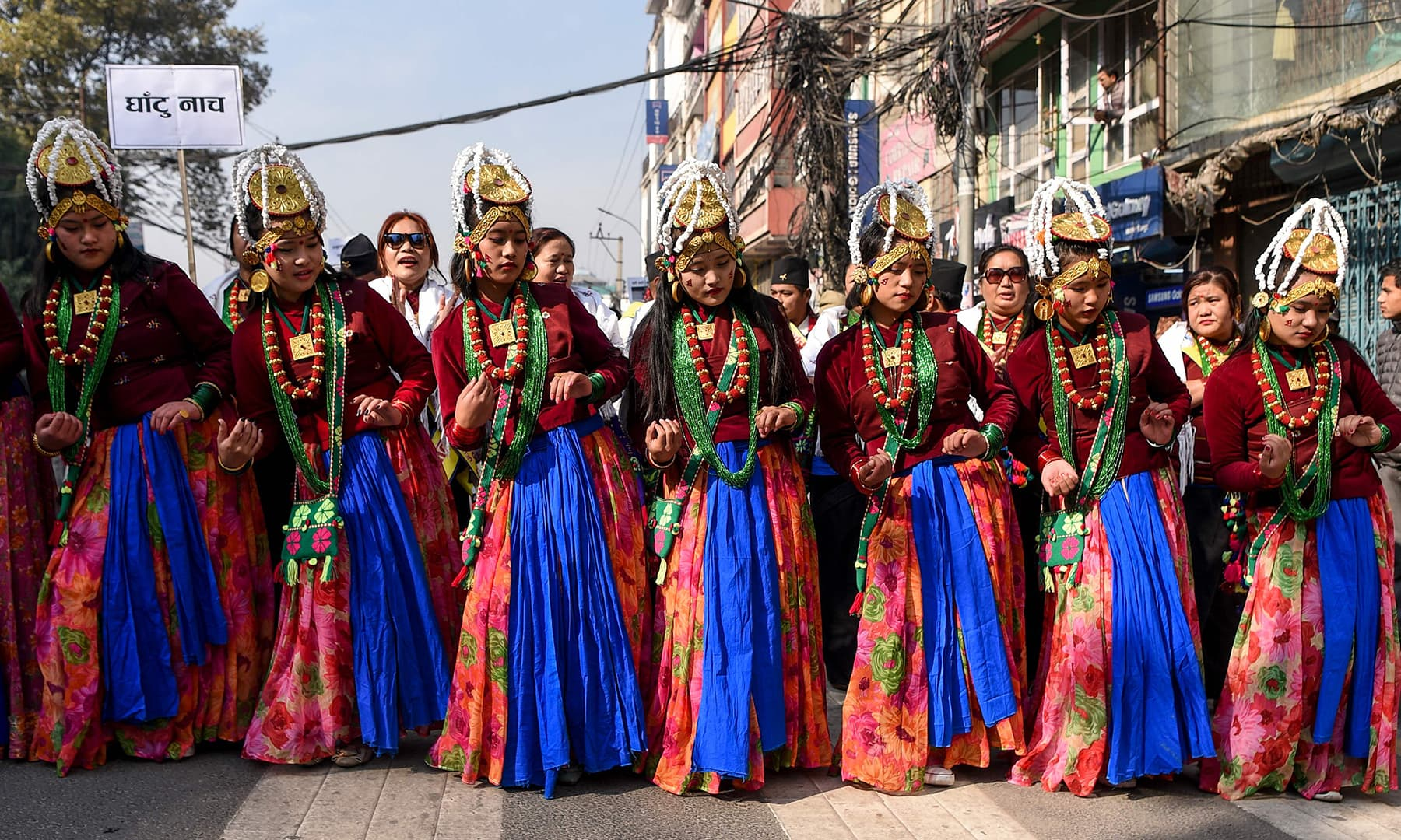 Members of the indigenous Gurung community wearing traditional attire perform as they take part in a New Year celebration ceremony known as 'Tamu Lhosar' in Kathmandu on Tuesday. — AFP