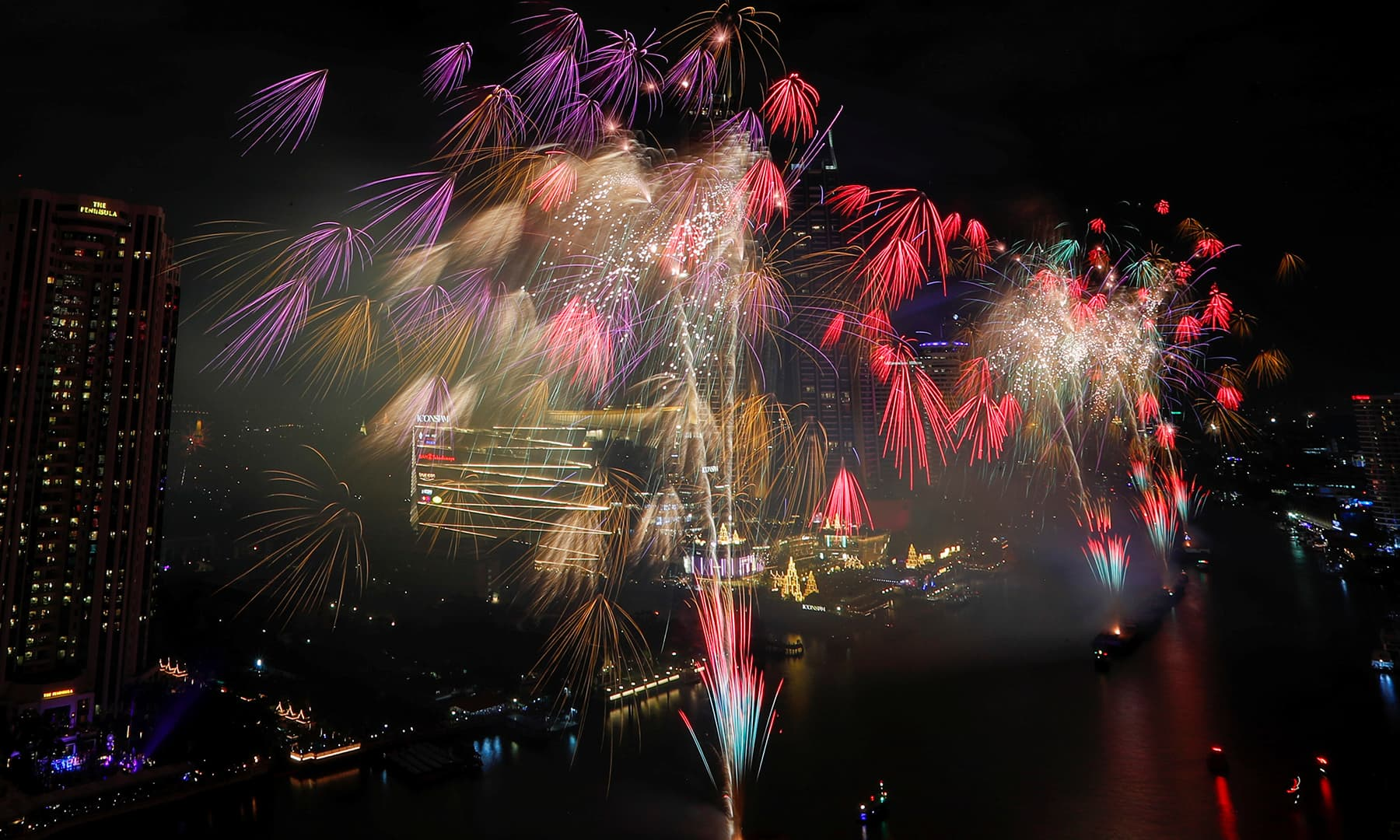 Fireworks explode over Chao Phraya River during the New Year's celebrations in Bangkok, Thailand, January 1, 2020. — Reuters