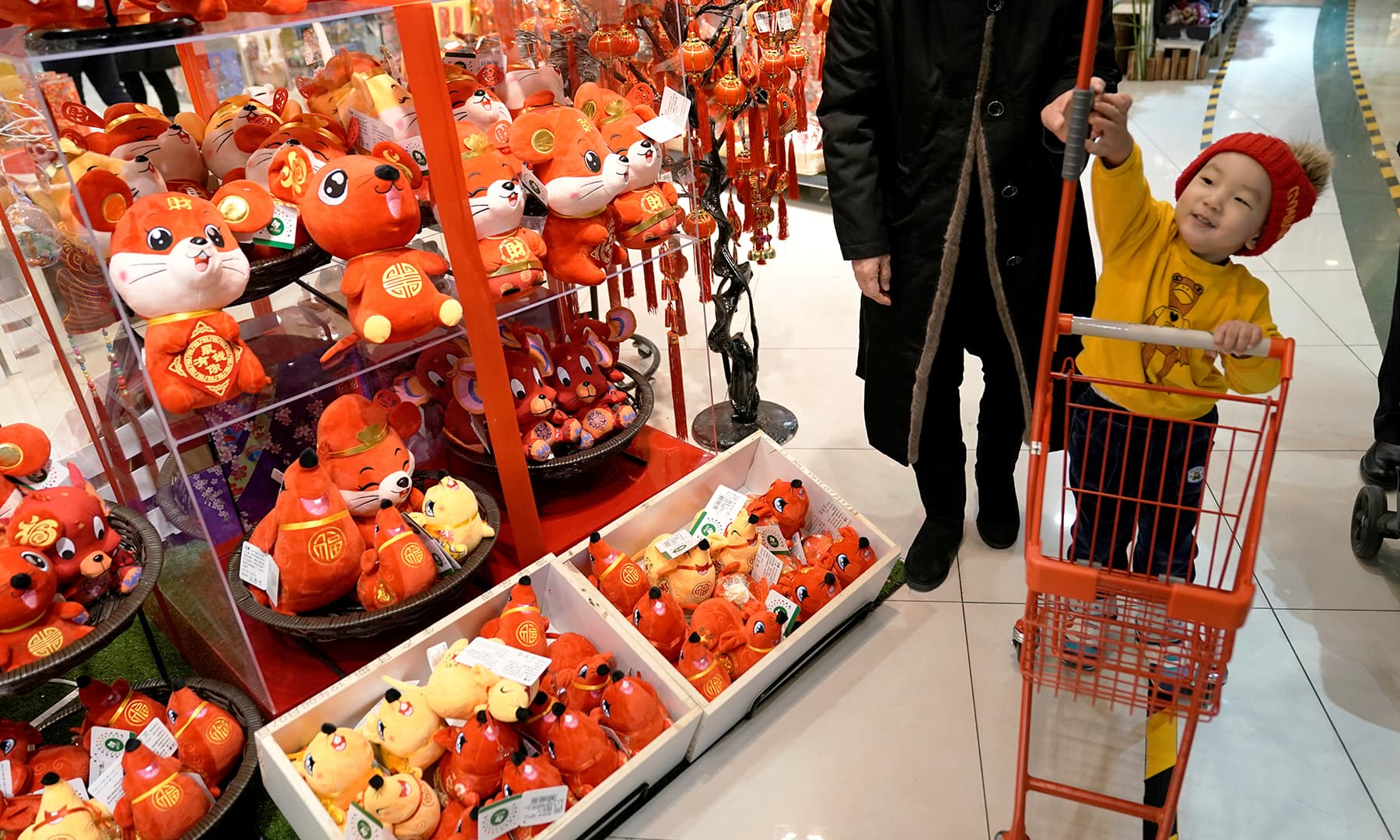 Lunar New Year of the Rat decorations are displayed for sale at a shopping mall in Beijing, China, on Tuesday. — Reuters