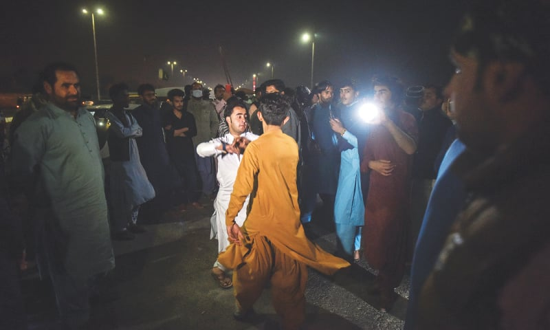 People celebrate by welcoming the New Year with traditional dance to loud music by the Seaview beach on Tuesday evening.—Fahim Siddiqi / White Star
