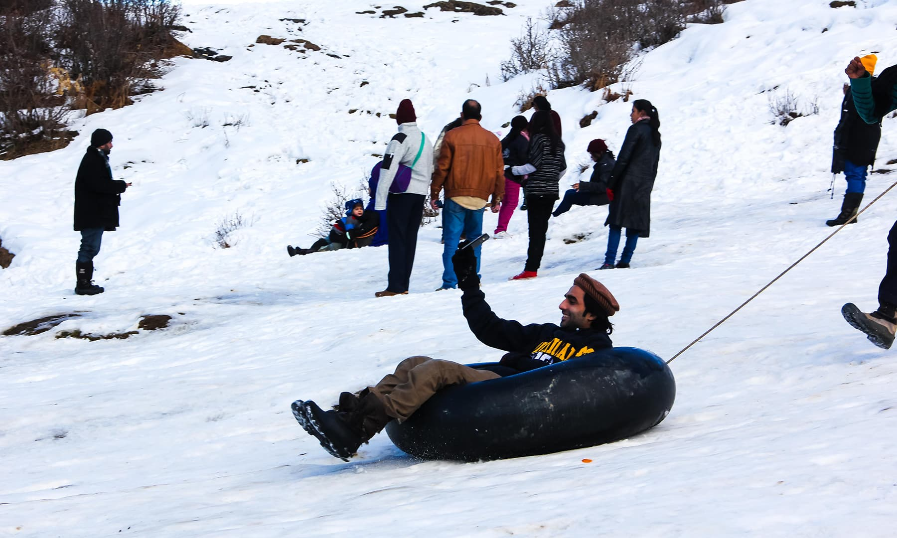 **A tourist whizzes past on a snow tube in Malam Jabba. — Photo by author**