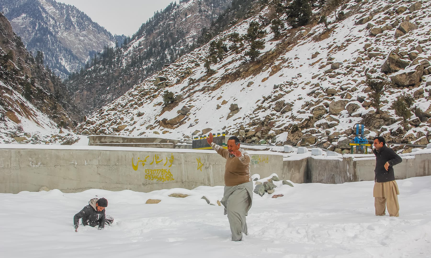 **Tourists celebrate in knee-deep snow in Kalam valley. — Photo by author**