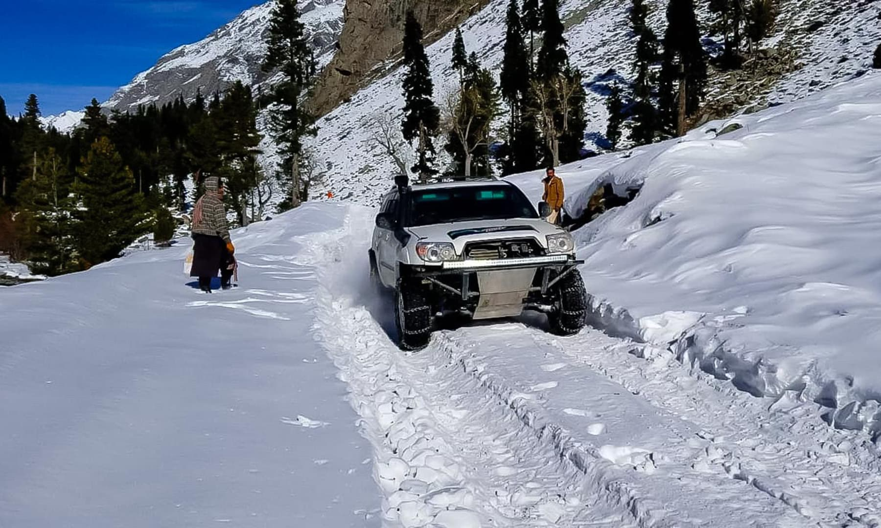 **A Jeep races on a snow covered track in Mahodand Kalam. — Photo by author**