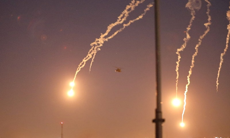 US Army AH-64 Apache helicopters from 1st Battalion, 227th Aviation Regiment, 34th Combat Aviation Brigade, launch flares as they conduct overflights of the US Embassy in Baghdad, Iraq on December 31. — US Army/Spc. Khalil Jenkins/CJTF-OIR Public Affairs/Handout via Reuters