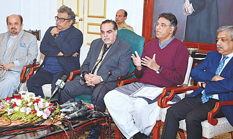 Federal Minister  for Planning and Development Asad Umar talks to the media after the Sindh Infrastructure Development Corporation meeting at  the Governor House on Wednesday.—APP