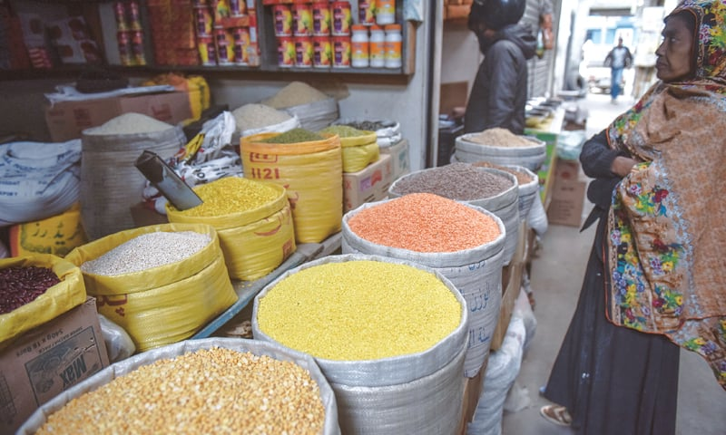CONSIDERING the high prices mentioned by the shopkeeper, a woman in a quandary over what to buy at a shop in the Shahabuddin Market on Thursday.—White Star