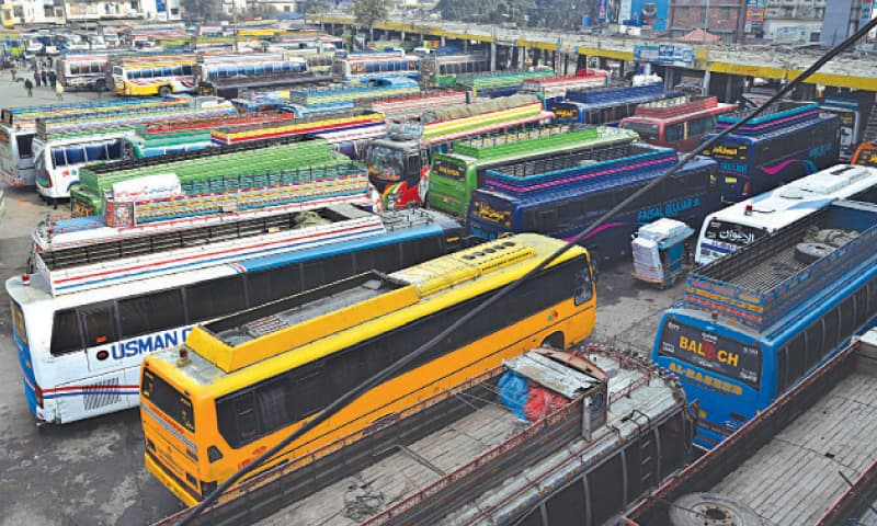 Buses are parked at Badami Bagh stand as transport owners observe a strike against increase in toll and fines. — White Star