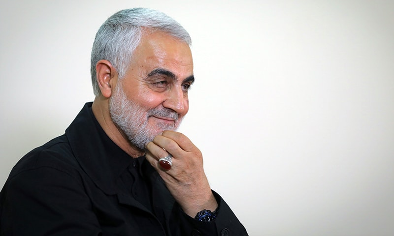 This file photo shows Qasem Soleimani wearing his trademark ring during an interview with members of the Iranian leader's bureau in Tehran. — AFP