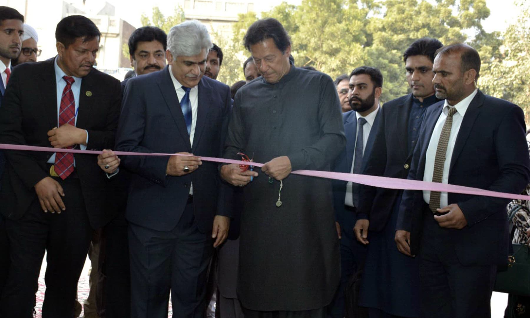 Prime Minister Imran Khan on Friday inaugurating Panahgah in Faisalabad on Friday. — PID