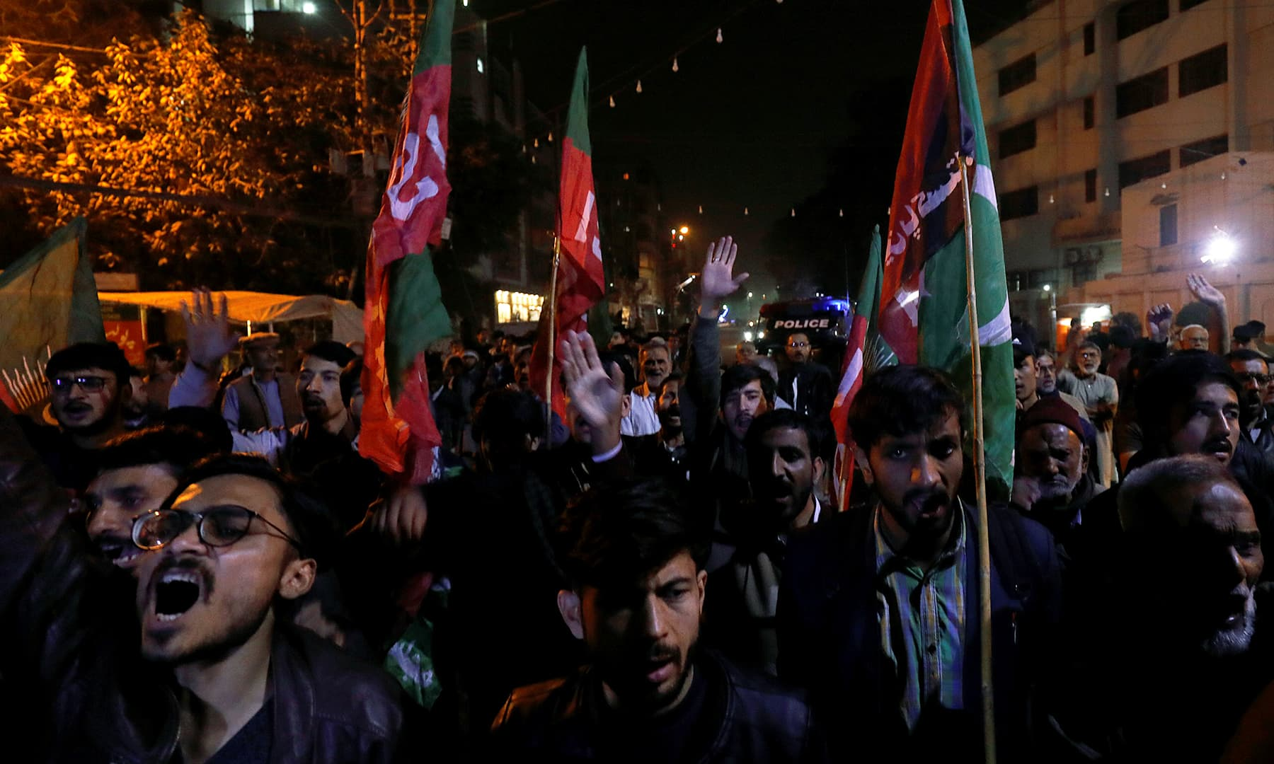 Supporters of Majlis-e-Wahdat-e-Muslimeen (MWM) chant slogans to mourn the death of Iranian Major-General Qassem Soleimani, in Karachi, on Friday. — Reuters