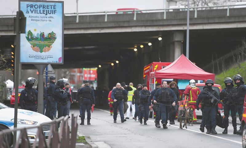 Paris: Police and firefighters gather at the site where police shot dead the knife-wielding man.—AFP