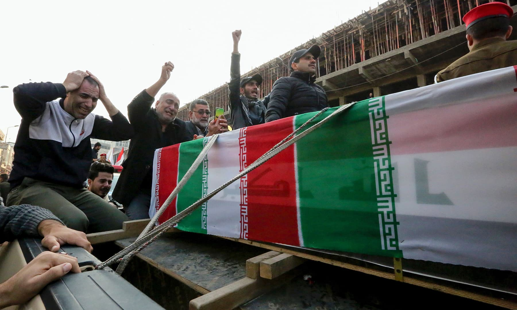 Iraqis mourn over a coffin during the funeral procession of Iraqi paramilitary chief Abu Mahdi al-Muhandis and Iranian military commander Qasem Soleimani, and eight others, in Kadhimiya, on January 4. — AFP