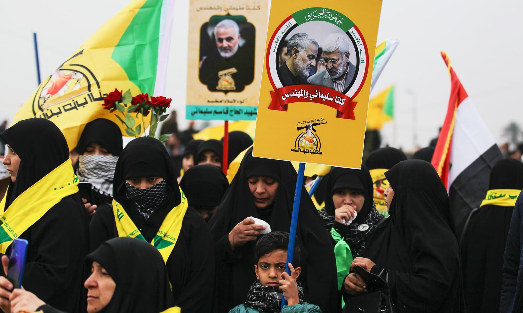 Supporters of the Hashed al-Shaabi paramilitary force and Iraq's Hezbollah brigades attend the funeral, in Baghdad's district of al-Jadriya, in Baghdad's high-security Green Zone, on January 4. — AFP