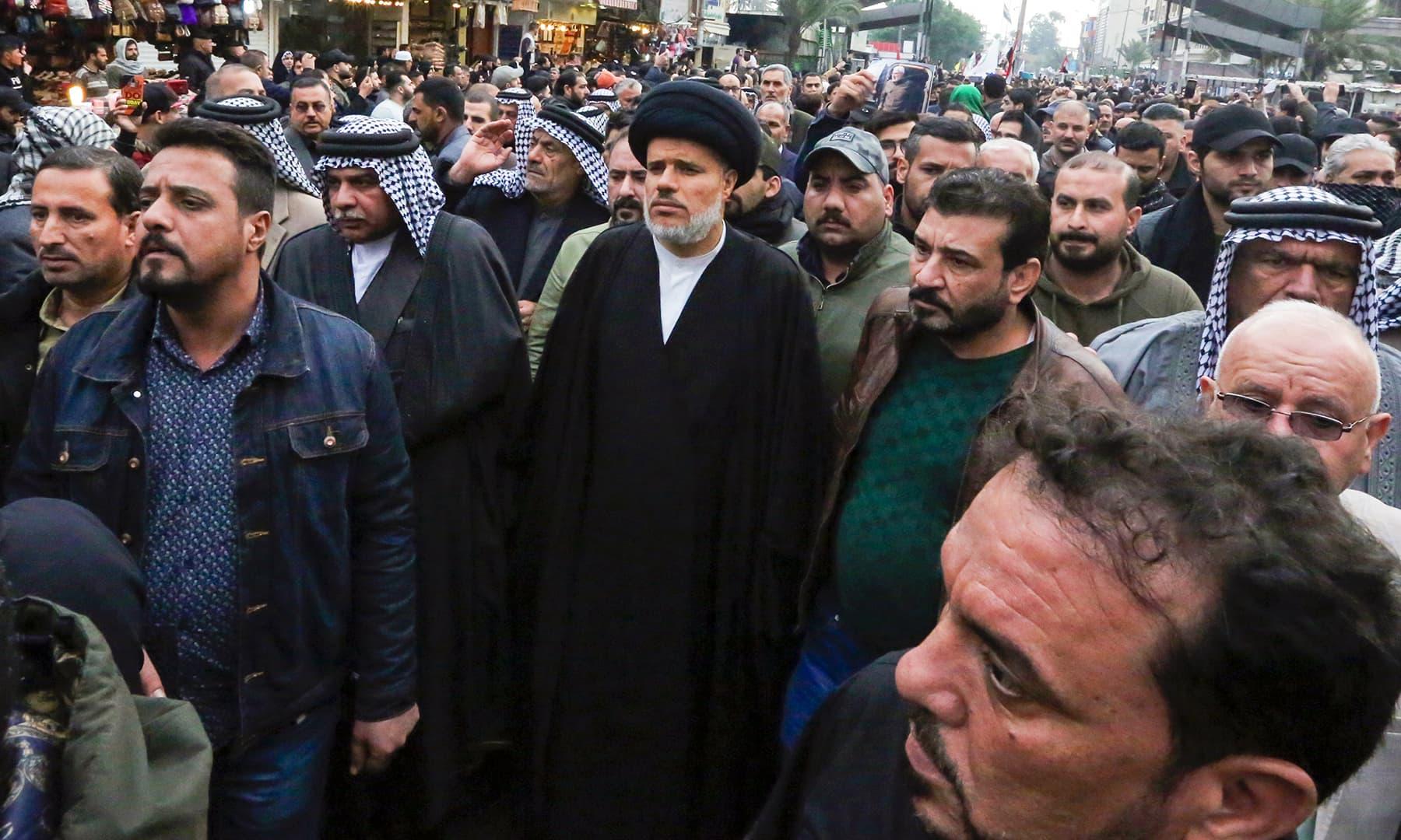 Mohammed al-Tabatabai (C), deputy Secretary General of the Asaib Ahl al-Haq faction, attends the funeral, in Kadhimiya, on January 4. — AFP