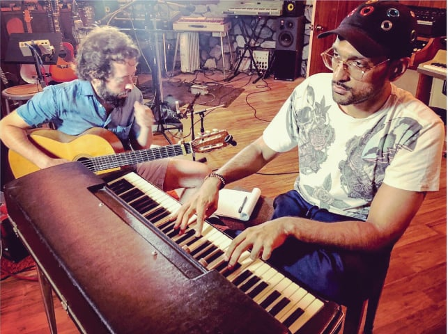 Four-time Grammy award winning producer Noah Georgeson and Ali Sethi in a studio in Los Angeles | Photo: Luis Ferra