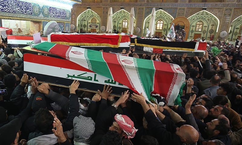 Mourners carry the coffins of Iran's Gen. Qassem Soleimani and Abu Mahdi al-Muhandis, deputy commander of Iran-backed militias at the Imam Ali shrine in Najaf, Iraq on  Saturday. — AP