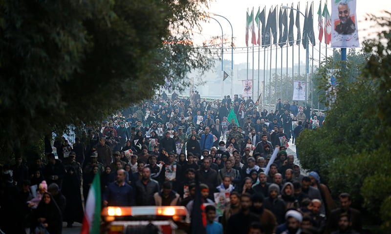 People attend a funeral procession for Iranian Major General Qassem Soleimani and Iraqi militia commander Abu Mahdi al-Muhandis who were killed in an air strike at Baghdad airport, in Iran on Jan 5. — Reuters