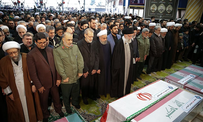 Iran's Supreme Leader Ayatollah Ali Khamenei leads a prayer over the caskets of slain Iranian military commander Qasem Soleimani.