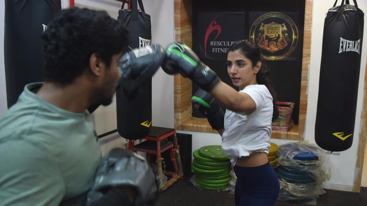 Aspiring actress Malhaar Rathod trains in a kickboxing session at a gym in Mumbai.