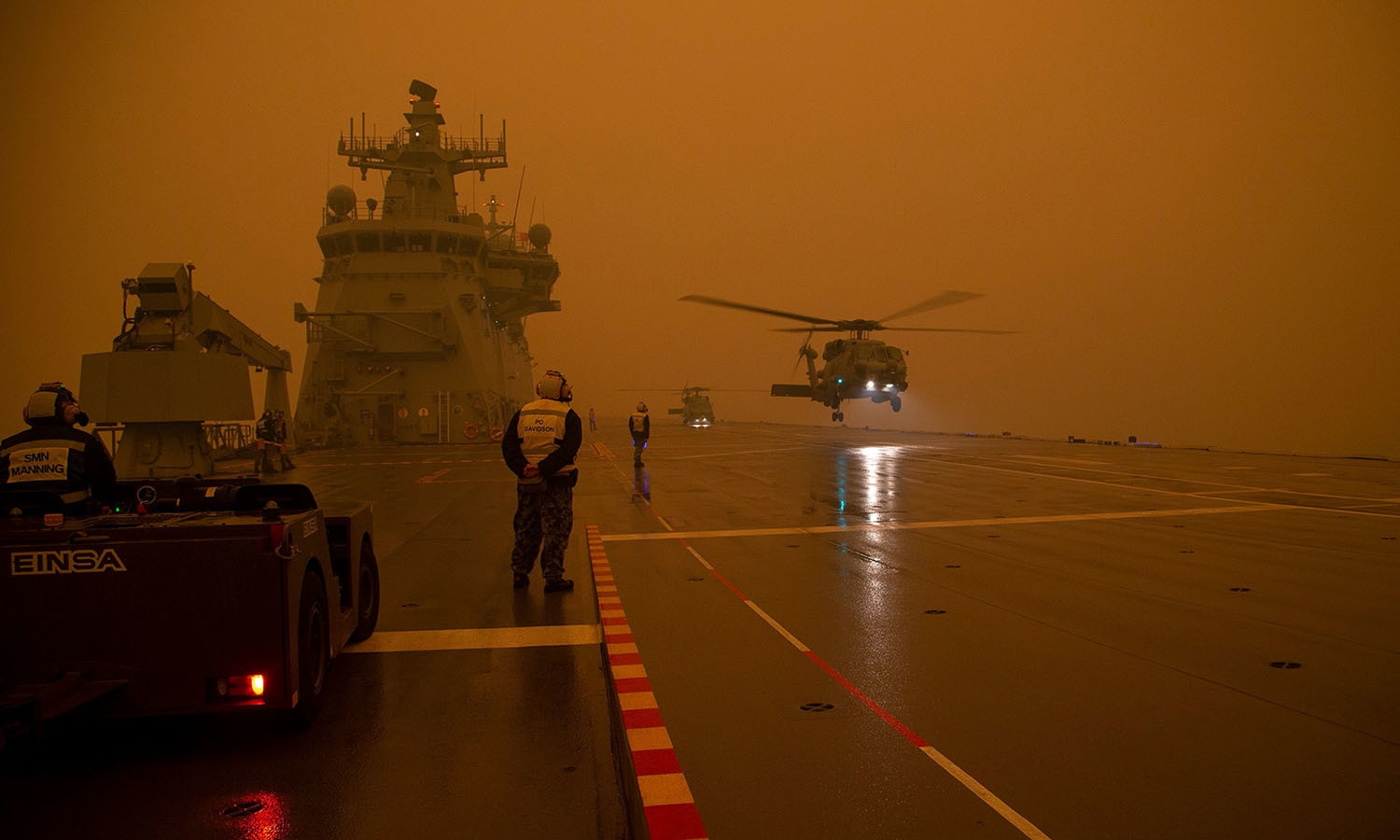 Royal Australian Navy MH-60R Seahawk 'Romeo' helicopters departing to take part in bushfire relief operations. — AFP