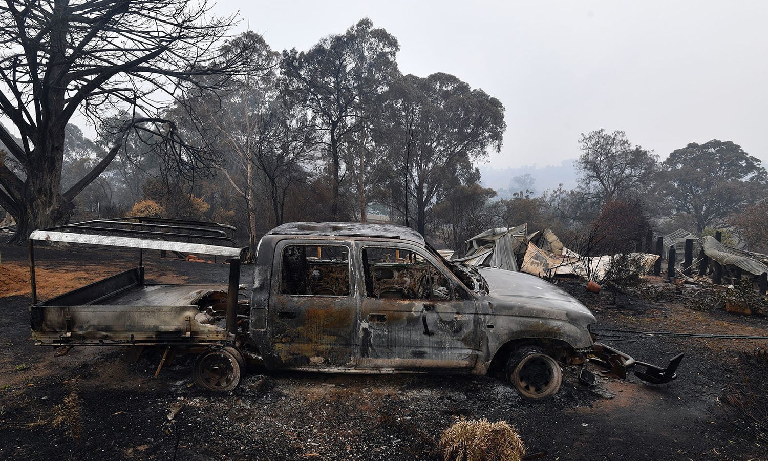 A woodchip mill burnt by bushfires in Australia. — AFP