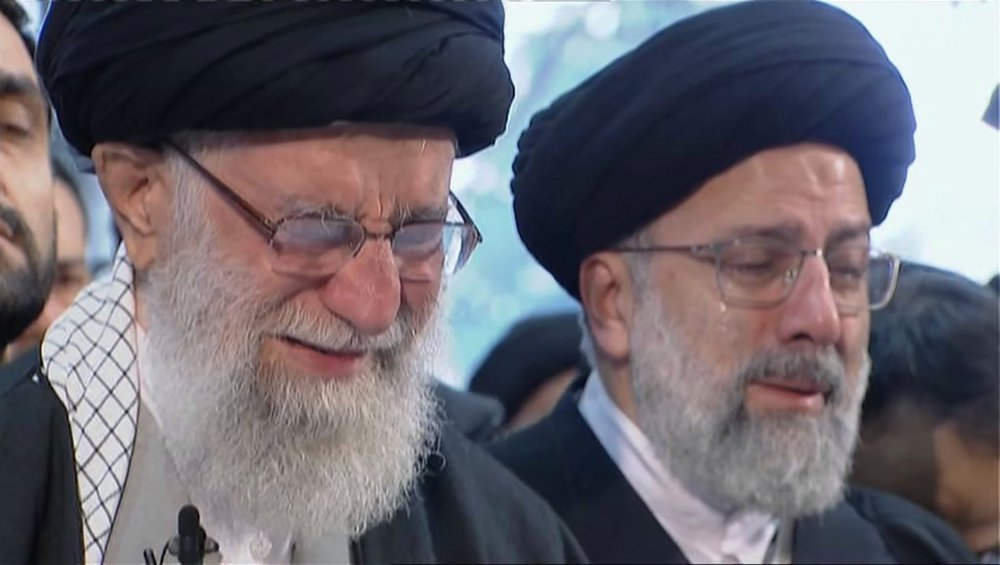 In this image taken from video, Iranian Supreme Leader Ayatollah Ali Khamenei, left, openly weeps as he leads a prayer over the coffin of General Qassem Soleimani at the Tehran University campus on Monday. — AP