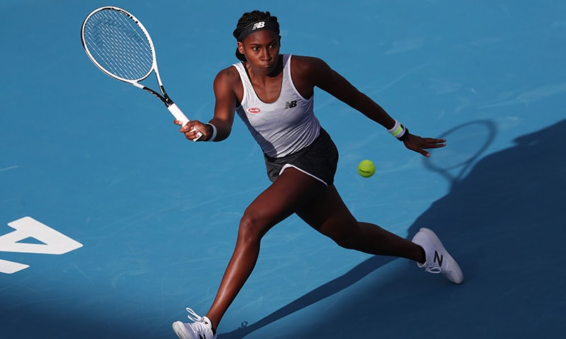 Cori Gauff of the US hits a return against Viktoria Kuzmova of Slovakia during their women's singles first round match during the Auckland Classic tennis tournament on Jan 6. — AFP
