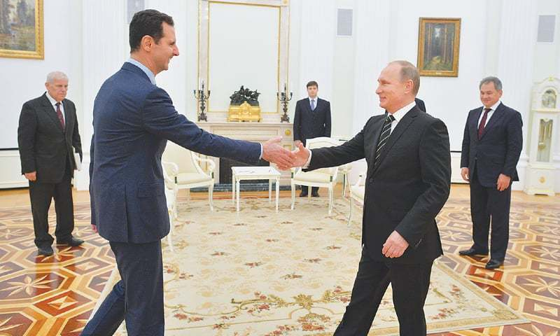 Russia's Putin makes rare visit to Syria, meets Assad