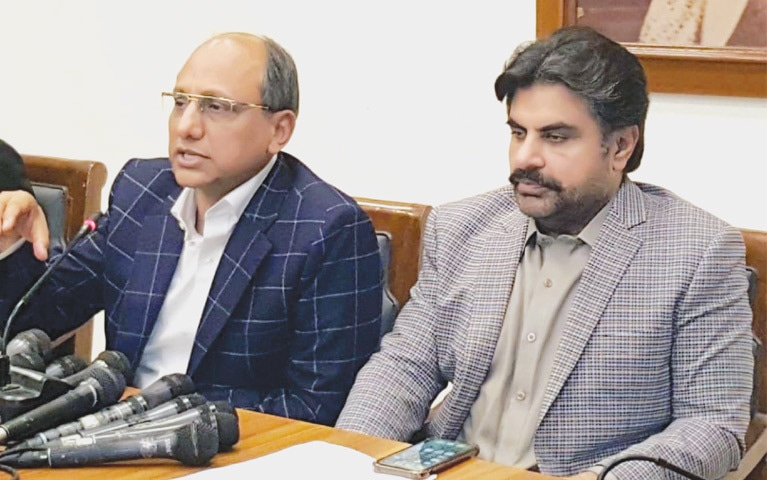 MINISTERS Saeed Ghani and Nasir Shah at the press conference on Tuesday.—PPI