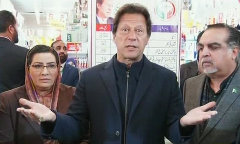 Prime Minister Imran Khan talks to media at a utility store in G-9 sector of Islamabad. — DawnNewsTV
